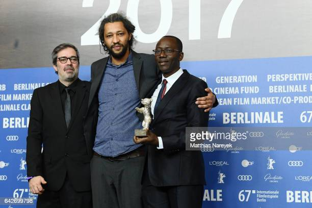 Producer Arnaud Dommerc film director Alain Gomis and producer Oumar Sall of the movie Felicite which won the Silver Bear Grand Jury Prize attend the...