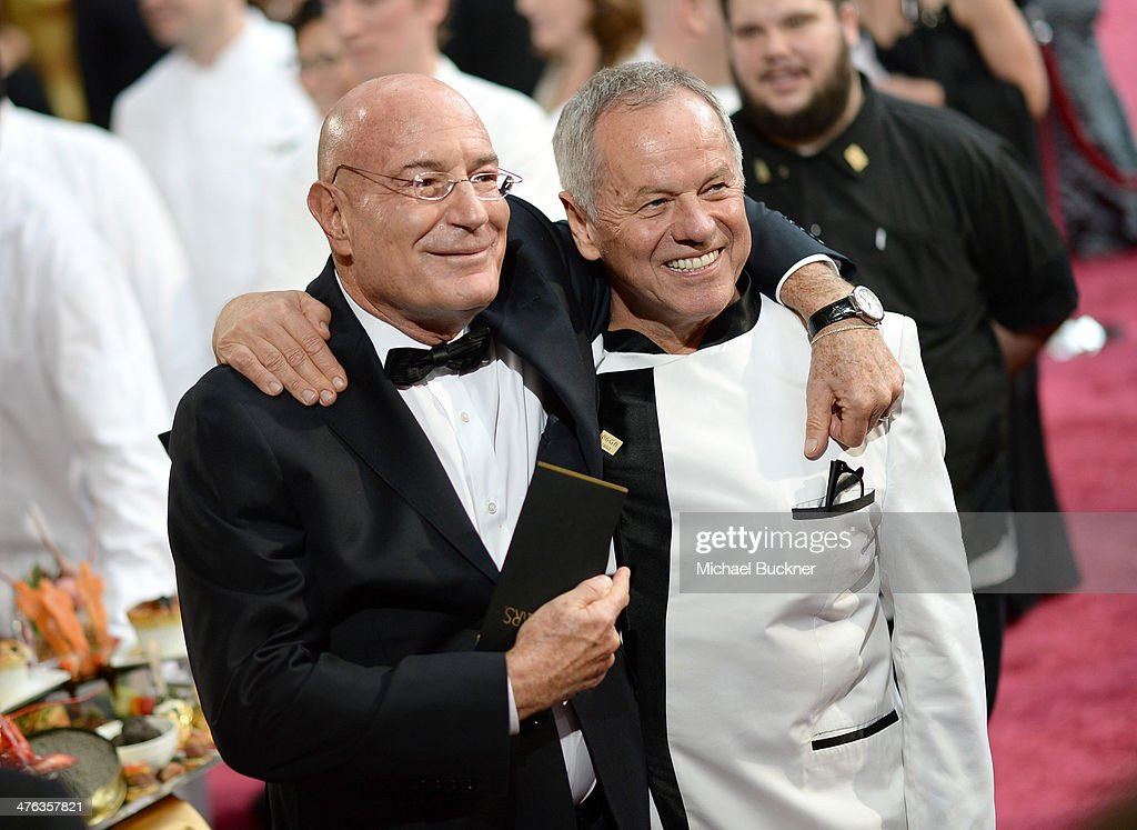Producer Arnon Milchan and chef Wolfgang Puck (R) and attend the Oscars held at Hollywood & Highland Center on March 2, 2014 in Hollywood, California.