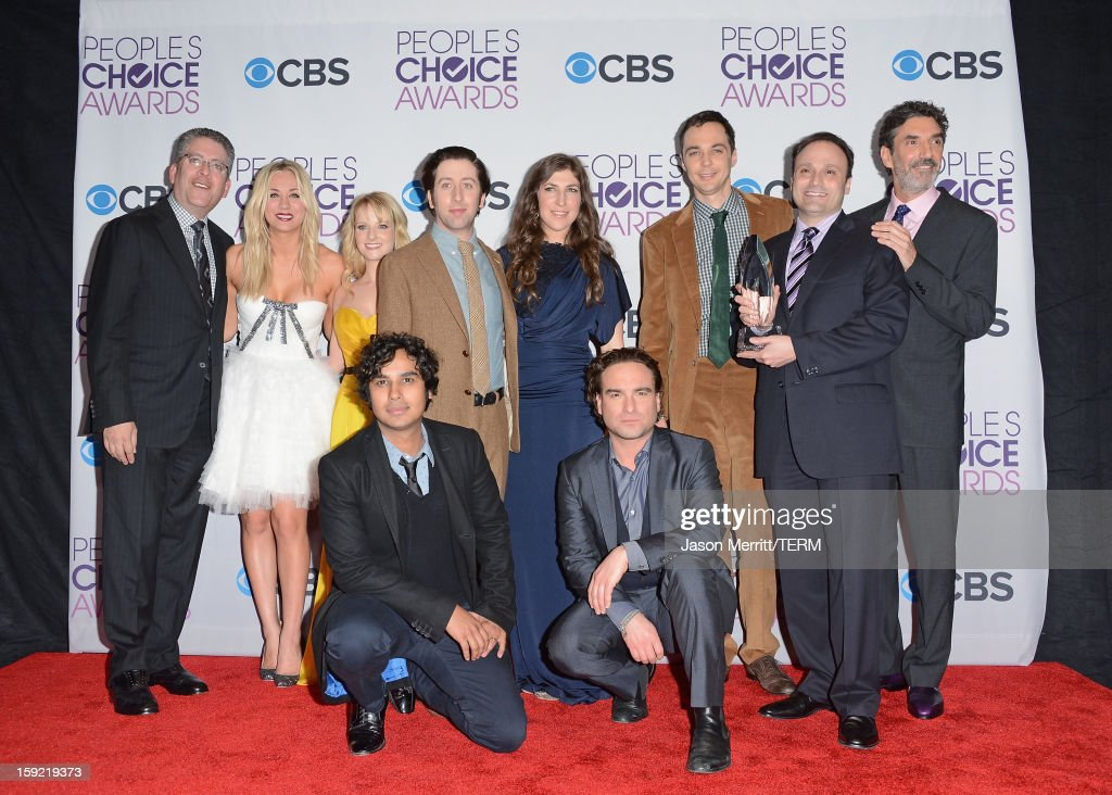 Producer Bill Prady, actors Kaley Cuoco, Melissa Rauch, Kunal Nayyar, Simon Helberg, Mayim Bialik, Johnny Galecki, Jim Parsons and producer Chuck Lorre of 'The Big Bang Theory' pose with the Favorite Network TV Comedy award in the press room at the 39th Annual People's Choice Awards at Nokia Theatre L.A. Live on January 9, 2013 in Los Angeles, California.
