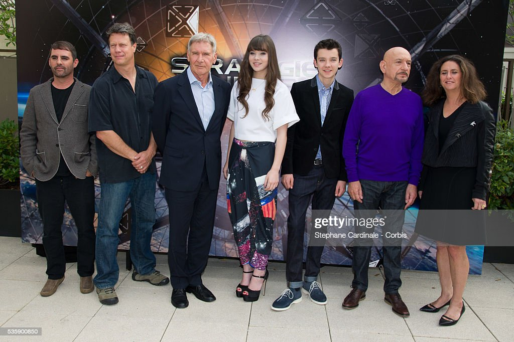Producer Bob Orci, Director Gavin Hood, Harrison Ford, Hailee Steinfeld, Asa Butterfield, Sir Ben Kingsley and Producer Gigi Pritzker attend the 'Ender's Game' Photocall, in Paris.