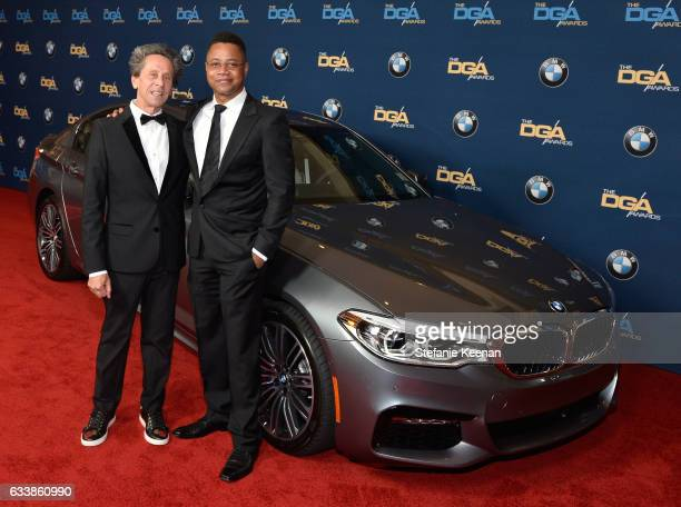 Producer Brian Grazer and actor Cuba Gooding Jr arrive in a BMW to the 69th Annual Directors Guild of America Awards at The Beverly Hilton Hotel on...