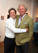 Producer Brian Grazer and Editorinchief US Vanity Fair Graydon Carter attend the art show 'Theurgy' at the Elga Wimmer Gallery on April 29 2010 in...