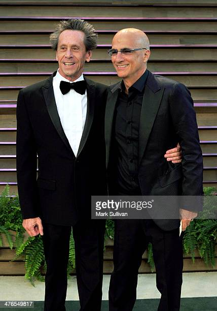 Producer Brian Grazer and film and music producer Jimmy Iovine attend the 2014 Vanity Fair Oscar Party hosted by Graydon Carter on March 2 2014 in...