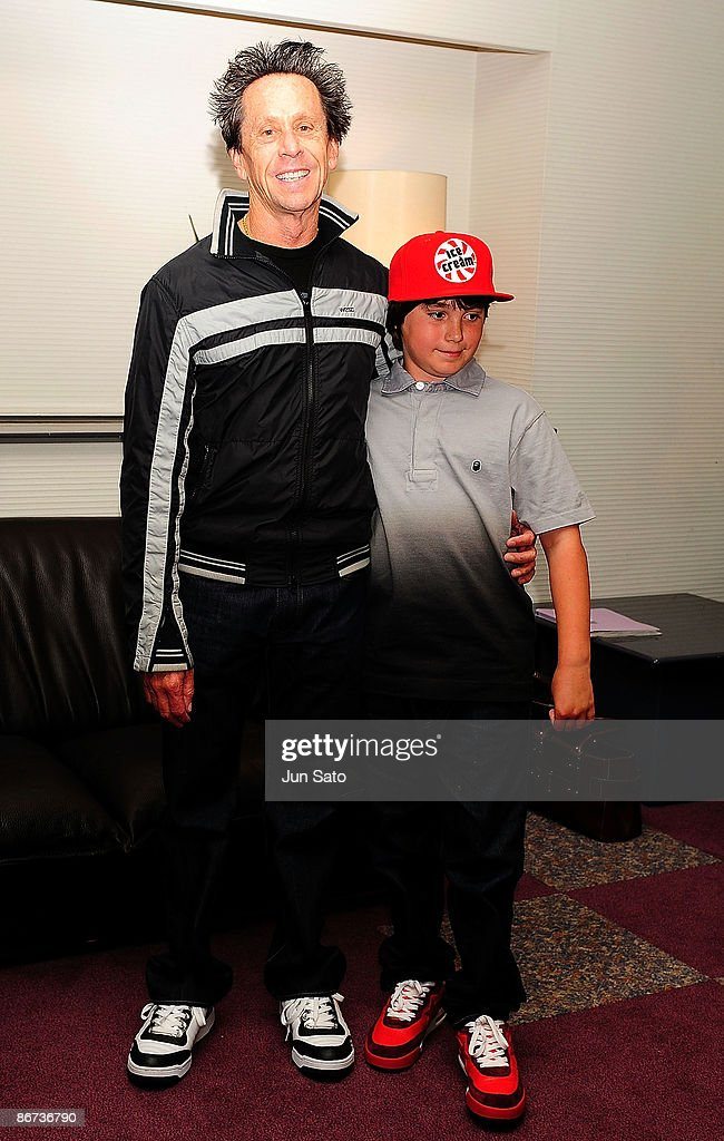 Producer Brian Grazer and his son Thomas Grazer pose at reception room during the ceremonial first pitch prior to the professional baseball match...
