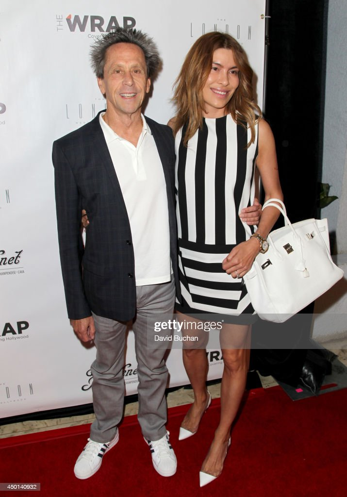 Producer <a gi-track='captionPersonalityLinkClicked' href=/galleries/search?phrase=Brian+Grazer&family=editorial&specificpeople=203009 ng-click='$event.stopPropagation()'>Brian Grazer</a> (L) and Veronica Smiley attend TheWrap's First Annual Emmy Party at The London West Hollywood on June 5, 2014 in West Hollywood, California.