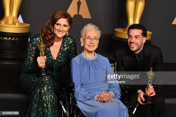 Producer Caroline Waterlow and director/producer Ezra Edelman winners of the award for Documentary for 'OJ Made in America' pose with physicist...