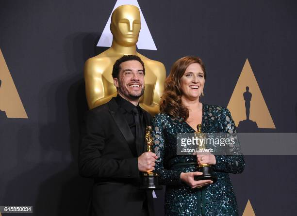 Producer Caroline Waterlow and director/producer Ezra Edelman winners of the award for Documentary for 'OJ Made in America' pose in the press room at...