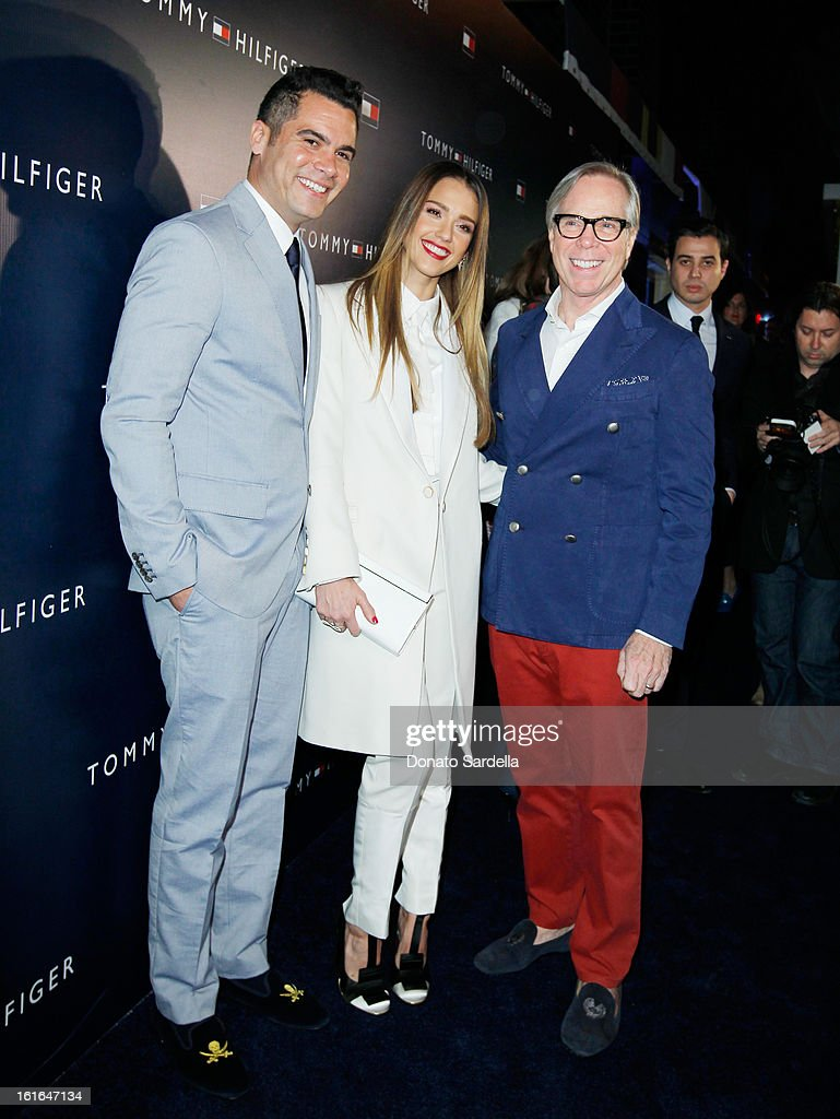 Producer Cash Warren, actress Jessica Alba and fashion designer Tommy Hilfiger attend Tommy Hilfiger New West Coast Flagship Opening on Robertson Boulevard on February 13, 2013 in West Hollywood, California.