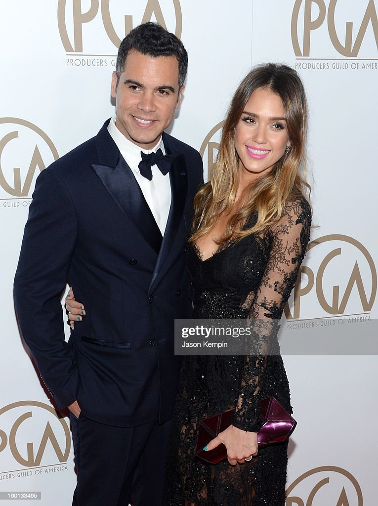 Producer Cash Warren (L) and actress Jessica Alba arrive at the 24th Annual Producers Guild Awards held at The Beverly Hilton Hotel on January 26, 2013 in Beverly Hills, California.