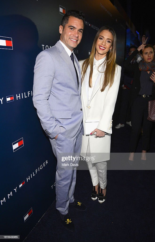 Producer Cash Warren and actress Jessica Alba attend Tommy Hilfiger New West Coast Flagship Opening on Robertson Boulevard on February 13 2013 in...