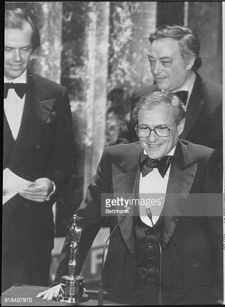 Producer Charles H Joffe accepts Woody Allen's Best Director Oscar for Annie Hall during the 50th Academy Awards In the background are actor Jack...