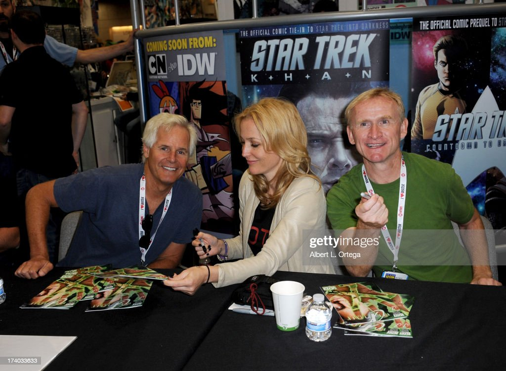 Producer Chris Carter, actress Gillian Anderson and actor Dean Haglund sign autographs during Comic-Con International at San Diego Convention Center on July 19, 2013 in San Diego, California.
