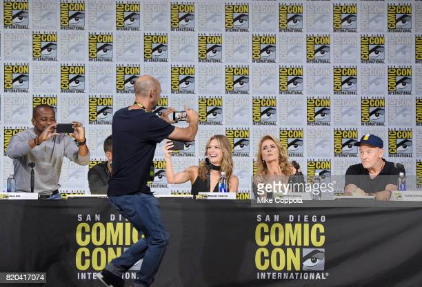 Producer Chris Henze takes a photo of actors Dule Hill James Roday Maggie Lawson Kirsten Nelson and Corbin Bernsen onstage at the 'Psych' reunion and...