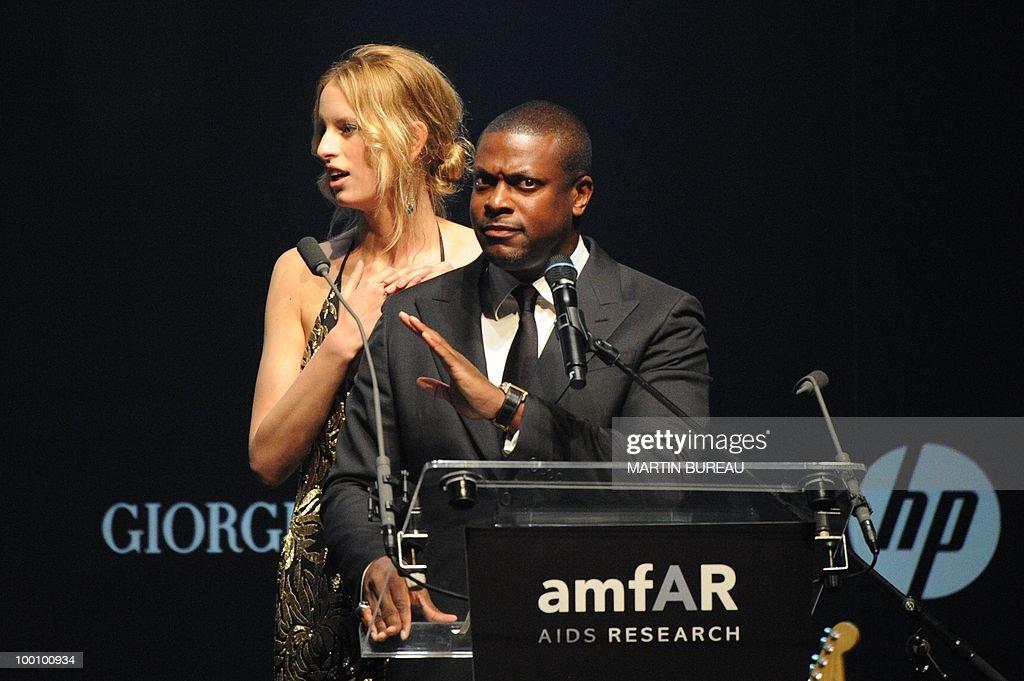 US producer Chris Tucker and Czech model Karolina Kurkova lead an auction at amfAR's Cinema Against Aids 2010 benefit gala on May 20, 2010 in Antibes, southeastern France.