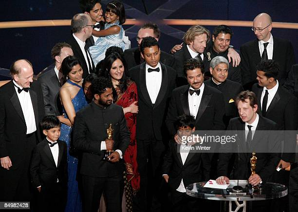 Producer Christian Colson with actors Freida Pinto Irrfan Khan Anil Kapoor and composer AR Rahman celebrate winning the Best Picture award for...