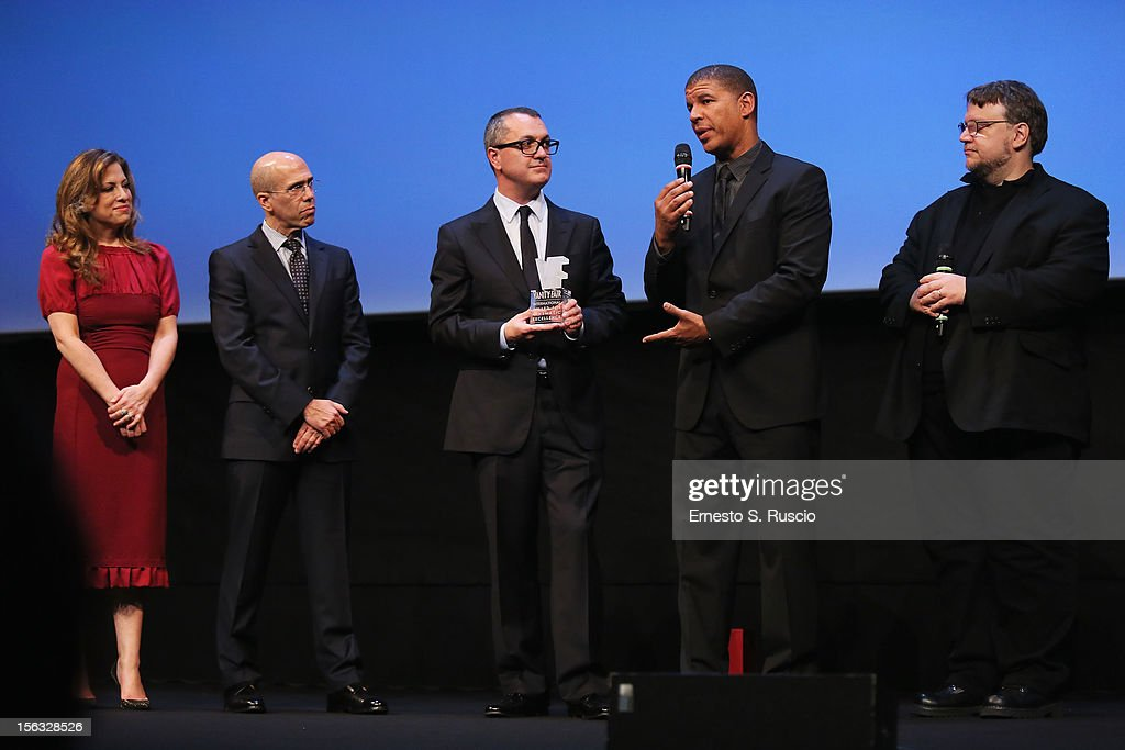 Producer Christina Steinberg, Jeffrey Katzenberg, Pappi Corsicato and Guillermo del Toro look on as director Peter Ramsey (2R) collects the Vanity Fair International Award for Cinematic Excellence for the film 'Rise of the Guardians' during a presentation at the 7th Rome Film Festival on November 13, 2012 in Rome, Italy.