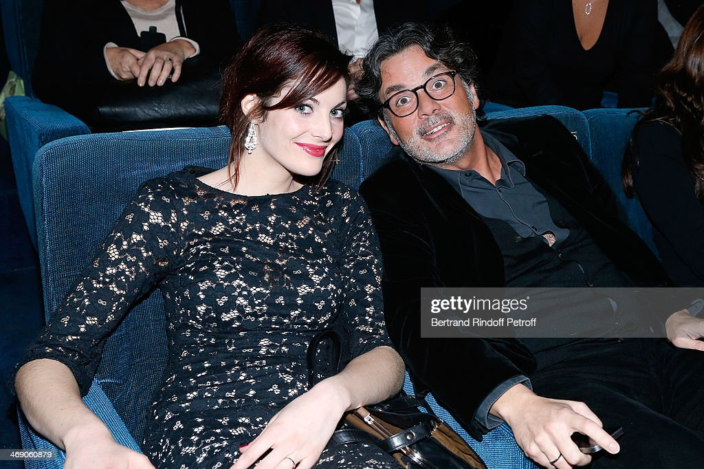 Producer Christophe Barratier and his companion Gwendoline Doytcheva attend the 'Monuments Men' Premiere at Cinema UGC Normandie on February 12 2014...