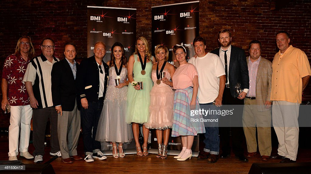 producer Chuck Ainlay, Sony Music Nashville's Gary Overton, BMI's Jody Williams, Sony ATV Music Publishing's Troy Tomlinson, co-writers Natalie Hemby and Nicolle Galyon, Miranda Lambert, Sony ATV Music Publishing's Abbey Adams, producer Frank Liddell, Warner/Chappell Music's BJ Hill, BMI's Bradley Collins, and Sony Music Nashville's Keith Gale attend the 'Automatic' No. 1 party on June 30, 2014 in Nashville, Tennessee.