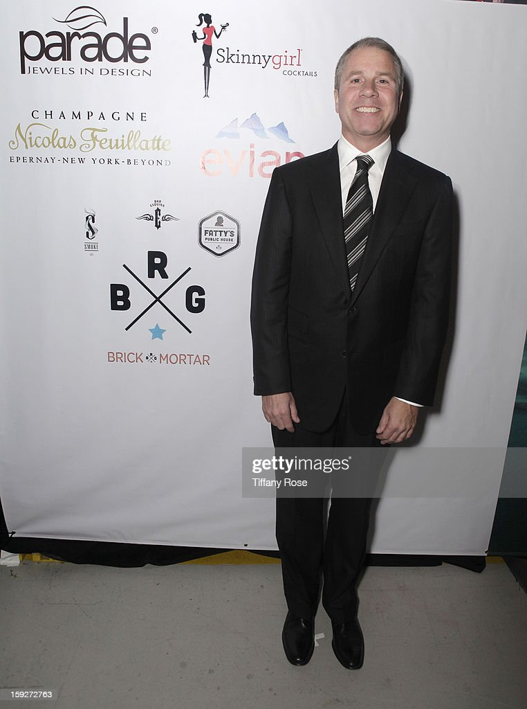 Producer Clark Spencer attends the Critics' Choice Movie Awards 2013 with Evian at Barkar Hangar on January 10, 2013 in Santa Monica, California.