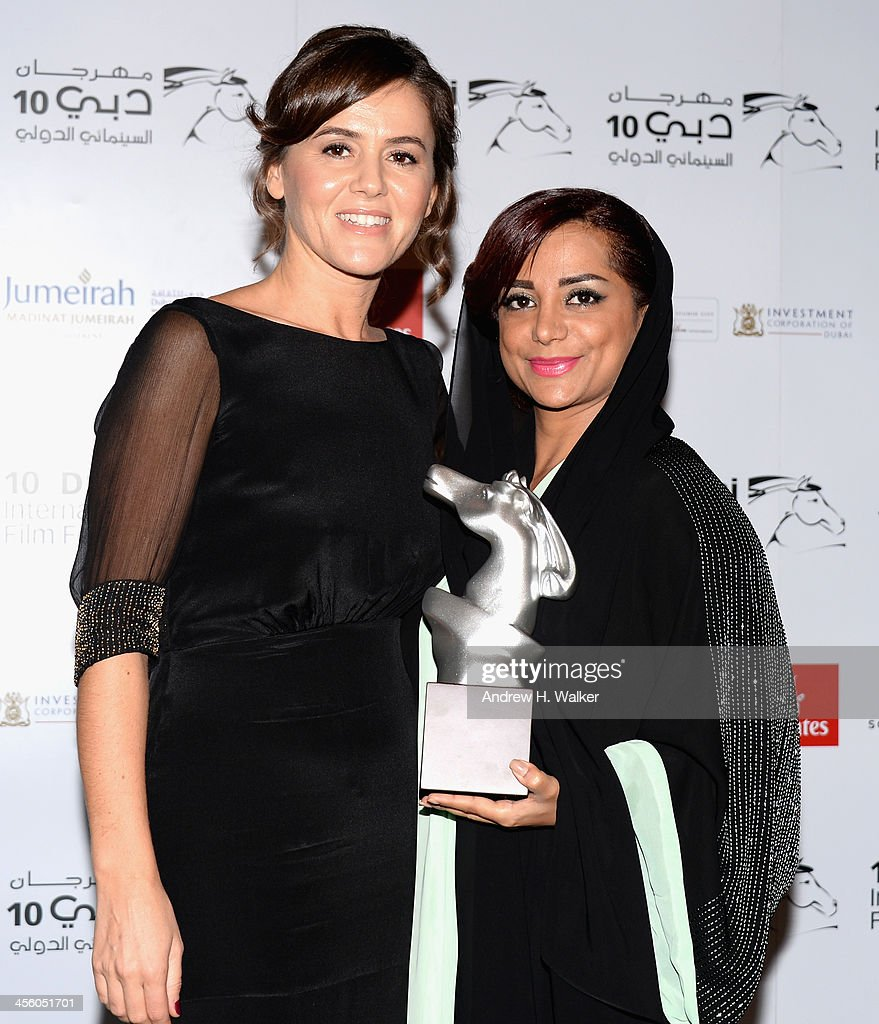 Producer Claudia Corbelli and director Nayla Al Khaja with their Muhr Emirati Special Jury Prize award at the Muhr Awards during day eight of the 10th Annual Dubai International Film Festival held at the Madinat Jumeriah Complex on December 13, 2013 in Dubai, United Arab Emirates.