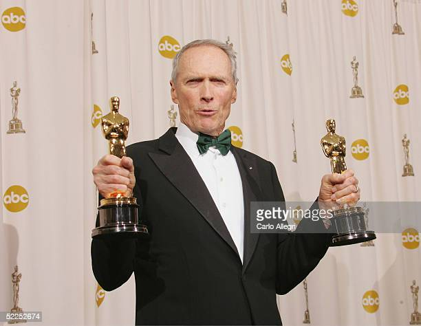 TELECAST*** Producer Clint Eastwood poses with his awards for Best Motion Picture and Best Director for 'Million Dollar Baby' backstage during the...