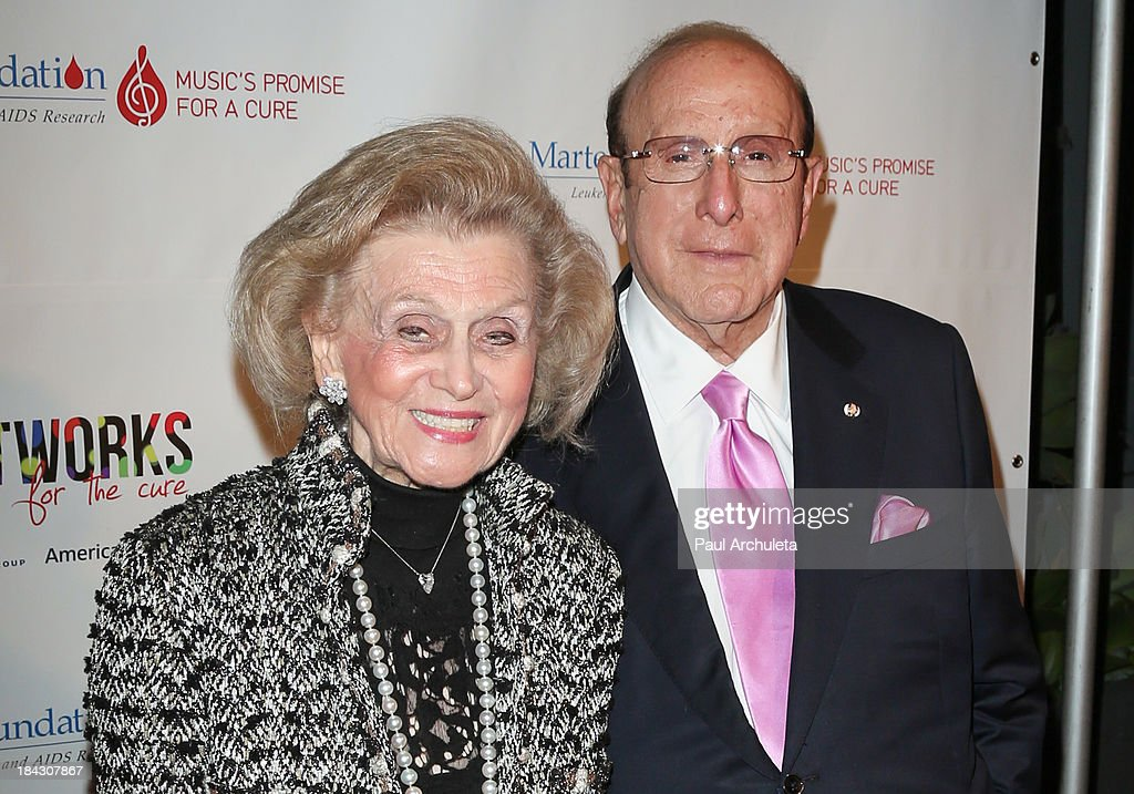 Producer <a gi-track='captionPersonalityLinkClicked' href=/galleries/search?phrase=Clive+Davis&family=editorial&specificpeople=209314 ng-click='$event.stopPropagation()'>Clive Davis</a> (R) and <a gi-track='captionPersonalityLinkClicked' href=/galleries/search?phrase=Barbara+Davis+-+Philanthropist&family=editorial&specificpeople=211590 ng-click='$event.stopPropagation()'>Barbara Davis</a> attend The T.J. Martell Foundation's 3rd annual Artworks For The Cure charity event at Barker Hangar on October 12, 2013 in Santa Monica, California.