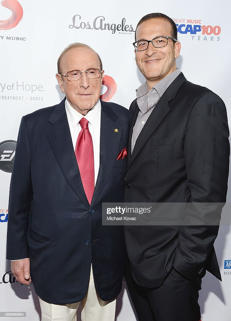 Producer <a gi-track='captionPersonalityLinkClicked' href=/galleries/search?phrase=Clive+Davis&family=editorial&specificpeople=209314 ng-click='$event.stopPropagation()'>Clive Davis</a> (L) and music executive <a gi-track='captionPersonalityLinkClicked' href=/galleries/search?phrase=Doug+Davis&family=editorial&specificpeople=211598 ng-click='$event.stopPropagation()'>Doug Davis</a> arrive at City of Hope's 10th Anniversary 'Songs Of Hope' on June 4, 2014 in Brentwood, California.