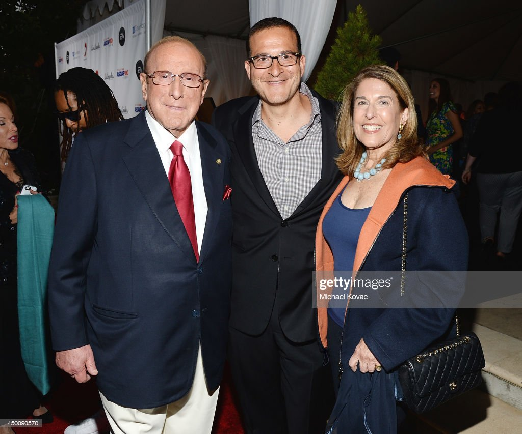 Producer <a gi-track='captionPersonalityLinkClicked' href=/galleries/search?phrase=Clive+Davis&family=editorial&specificpeople=209314 ng-click='$event.stopPropagation()'>Clive Davis</a>, music executive <a gi-track='captionPersonalityLinkClicked' href=/galleries/search?phrase=Doug+Davis&family=editorial&specificpeople=211598 ng-click='$event.stopPropagation()'>Doug Davis</a>, and Janet Davis arrive at City of Hope's 10th Anniversary 'Songs Of Hope' on June 4, 2014 in Brentwood, California.