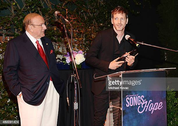 Producer Clive Davis presents the 'Legend in Songwriting' Award to songwriter Dr Luke at City Of Hope's 10th Anniversary 'Songs Of Hope' on June 4...