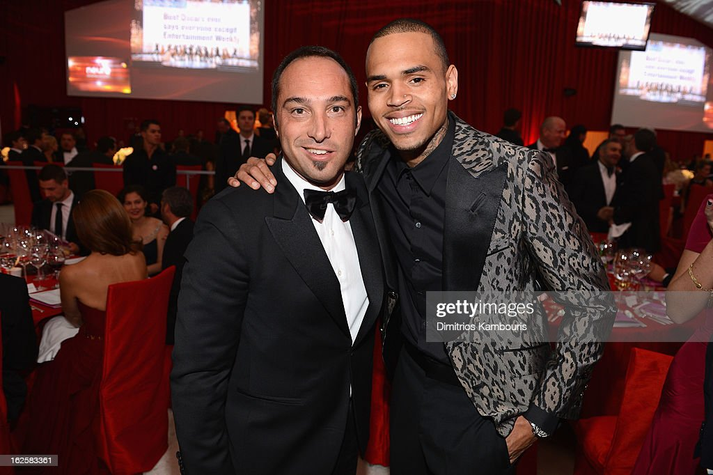 Producer Cristiano de Masi and singer Chris Brown attend the 21st Annual Elton John AIDS Foundation Academy Awards Viewing Party at West Hollywood Park on February 24, 2013 in West Hollywood, California.