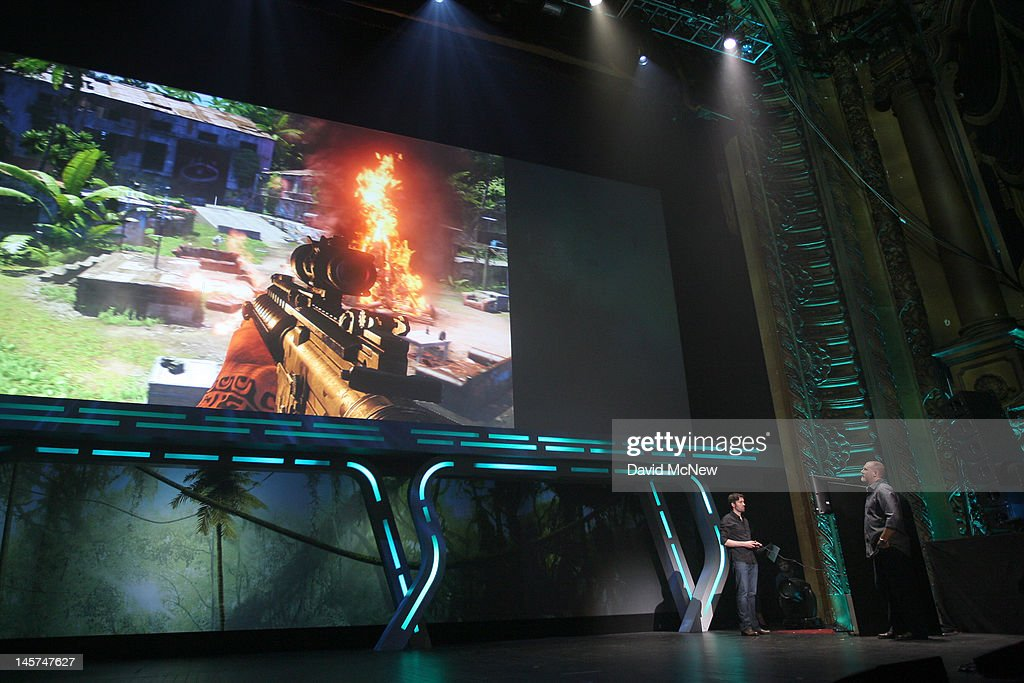 Producer Dan Hay (R) demonstrates the violent game Far Cry 3 at the Ubisoft press conference on the eve of the Electronic Entertainment Expo (E3) on June 4, 2012 in Los Angeles, California. E3 is the most important yearly trade show the $78.5 billion videogame industry.