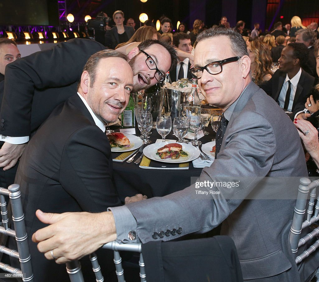 Producer <a gi-track='captionPersonalityLinkClicked' href=/galleries/search?phrase=Dana+Brunetti&family=editorial&specificpeople=566513 ng-click='$event.stopPropagation()'>Dana Brunetti</a>, actor <a gi-track='captionPersonalityLinkClicked' href=/galleries/search?phrase=Kevin+Spacey&family=editorial&specificpeople=202091 ng-click='$event.stopPropagation()'>Kevin Spacey</a>, and actor <a gi-track='captionPersonalityLinkClicked' href=/galleries/search?phrase=Tom+Hanks&family=editorial&specificpeople=201790 ng-click='$event.stopPropagation()'>Tom Hanks</a> with Champagne Nicolas Feuillatte at the 19th Annual Critics' Choice Movie Awards at Barker Hangar on January 16, 2014 in Santa Monica, California.