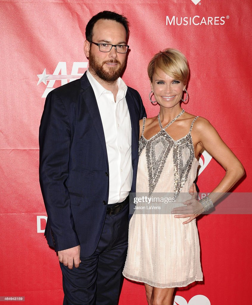 Producer Dana Brunetti and actress Kristin Chenoweth attend the 2014 MusiCares Person of the Year honoring Carole King at Los Angeles Convention Center on January 24, 2014 in Los Angeles, California.