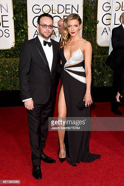 Producer Dana Brunetti and Katie Cassidy attend the 72nd Annual Golden Globe Awards at The Beverly Hilton Hotel on January 11 2015 in Beverly Hills...