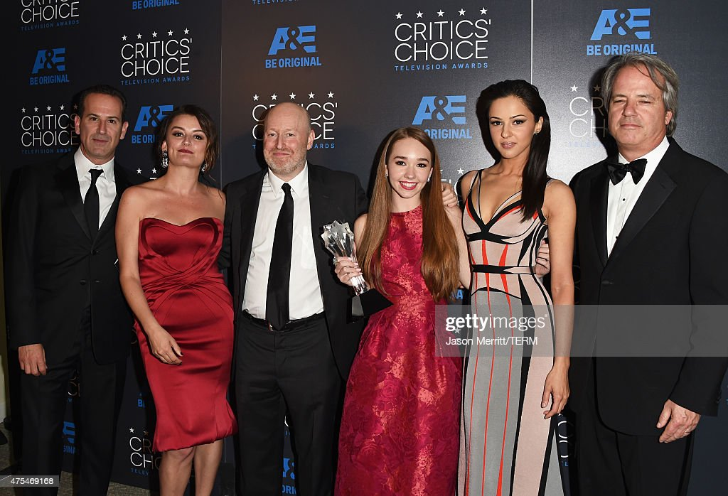 Producer Darryl Frank, actress <a gi-track='captionPersonalityLinkClicked' href=/galleries/search?phrase=Alison+Wright+-+Actress&family=editorial&specificpeople=2822437 ng-click='$event.stopPropagation()'>Alison Wright</a>, writer-producer Joe Weisberg, actors <a gi-track='captionPersonalityLinkClicked' href=/galleries/search?phrase=Holly+Taylor&family=editorial&specificpeople=8137665 ng-click='$event.stopPropagation()'>Holly Taylor</a>, <a gi-track='captionPersonalityLinkClicked' href=/galleries/search?phrase=Annet+Mahendru&family=editorial&specificpeople=7013540 ng-click='$event.stopPropagation()'>Annet Mahendru</a> and producer <a gi-track='captionPersonalityLinkClicked' href=/galleries/search?phrase=Graham+Yost&family=editorial&specificpeople=4111749 ng-click='$event.stopPropagation()'>Graham Yost</a> pose with the Best Drama Series award for 'The Americans' in the press room at the 5th Annual Critics' Choice Television Awards at The Beverly Hilton Hotel on May 31, 2015 in Beverly Hills, California.
