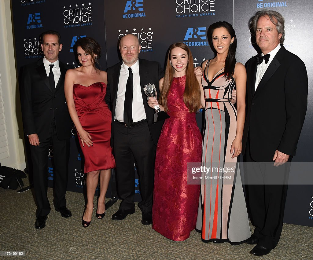 Producer Darryl Frank, actress <a gi-track='captionPersonalityLinkClicked' href=/galleries/search?phrase=Alison+Wright&family=editorial&specificpeople=2822437 ng-click='$event.stopPropagation()'>Alison Wright</a>, writer-producer Joe Weisberg, actors <a gi-track='captionPersonalityLinkClicked' href=/galleries/search?phrase=Holly+Taylor&family=editorial&specificpeople=8137665 ng-click='$event.stopPropagation()'>Holly Taylor</a>, <a gi-track='captionPersonalityLinkClicked' href=/galleries/search?phrase=Annet+Mahendru&family=editorial&specificpeople=7013540 ng-click='$event.stopPropagation()'>Annet Mahendru</a> and producer <a gi-track='captionPersonalityLinkClicked' href=/galleries/search?phrase=Graham+Yost&family=editorial&specificpeople=4111749 ng-click='$event.stopPropagation()'>Graham Yost</a> pose with the Best Drama Series award for 'The Americans' in the press room at the 5th Annual Critics' Choice Television Awards at The Beverly Hilton Hotel on May 31, 2015 in Beverly Hills, California.