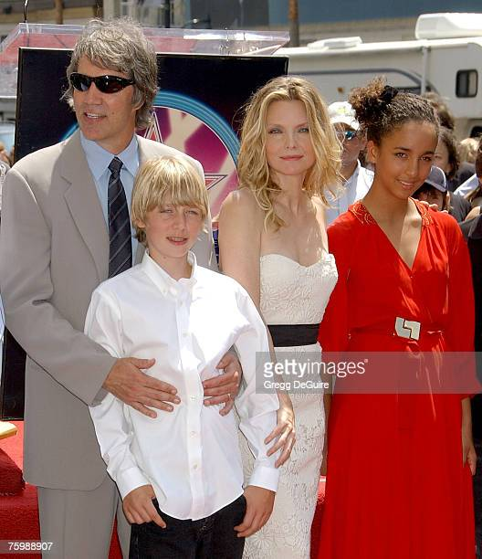 Producer David E Kelley actress Michelle Pfeiffer and children pose for the media at Michelle Pfeiffer's Hollywood Star Walk of Fame ceremony on...