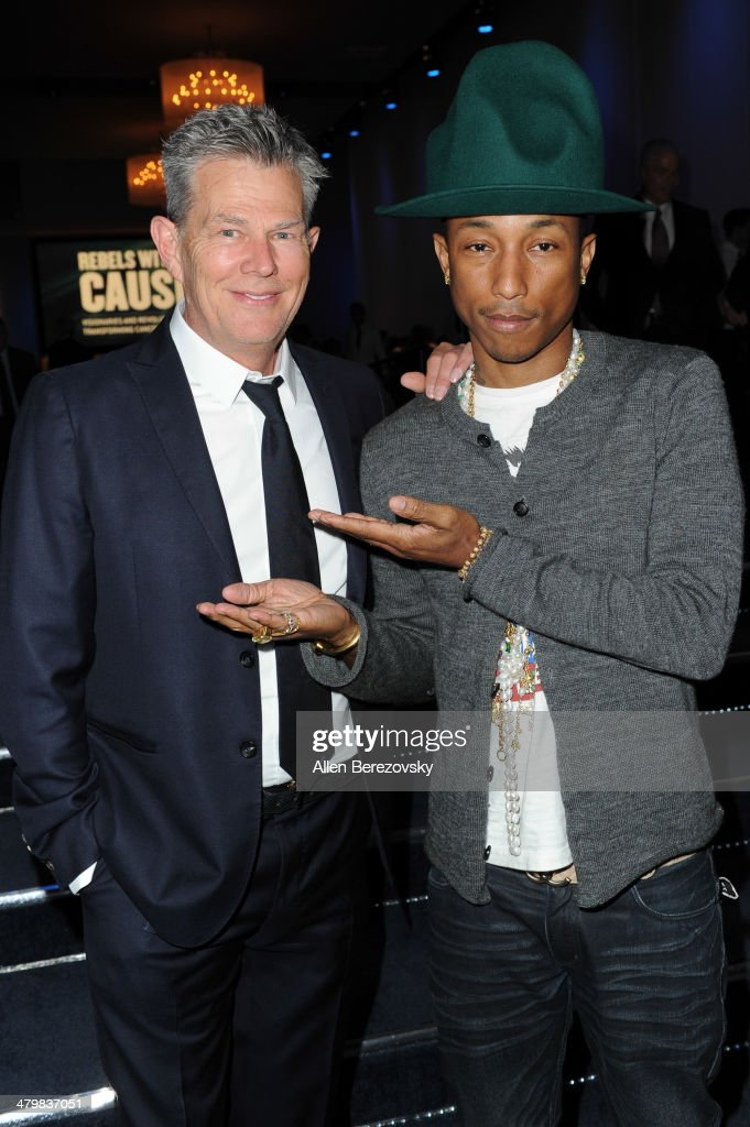 Producer <a gi-track='captionPersonalityLinkClicked' href=/galleries/search?phrase=David+Foster&family=editorial&specificpeople=210611 ng-click='$event.stopPropagation()'>David Foster</a> (L) and recording artist <a gi-track='captionPersonalityLinkClicked' href=/galleries/search?phrase=Pharrell+Williams&family=editorial&specificpeople=161396 ng-click='$event.stopPropagation()'>Pharrell Williams</a> attend the 2nd Annual Rebel With A Cause Gala cocktail reception at Paramount Studios on March 20, 2014 in Hollywood, California.