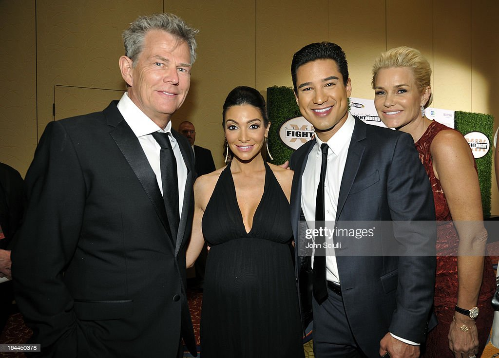 Producer David Foster, Courtney Laine Mazza, TV Personality Mario Lopez, and TV Personality Yolanda Hadid attend Muhammad Ali's Celebrity Fight Night XIX at JW Marriott Desert Ridge Resort & Spa on March 23, 2013 in Phoenix, Arizona.