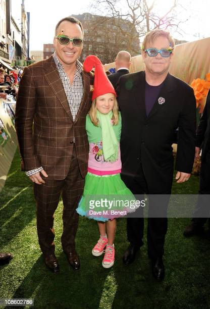 Producer David Furnish Esme Bertlesen and Executive Producer Sir Elton John attend the UK film premiere of Gnomeo and Juliet at Odeon Leicester...
