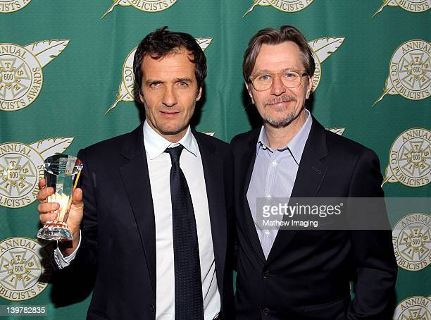 Producer David Heyman recipieint of the Motion Picture Showmanship Award and actor Gary Oldman attend the 49th Annual ICG Publicists Awards place at...
