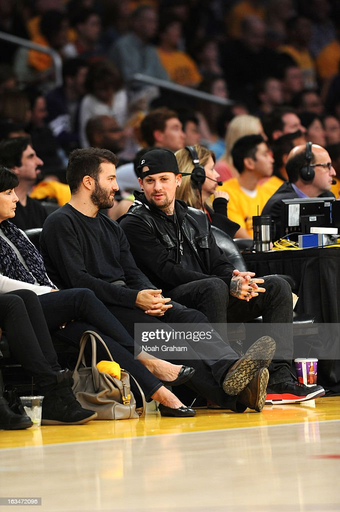 Producer David Katzenberg and recording artist Benji Madden have a conversation courtside during a game between the Chicago Bulls and the Los Angeles Lakers at Staples Center on March 10, 2013 in Los Angeles, California.