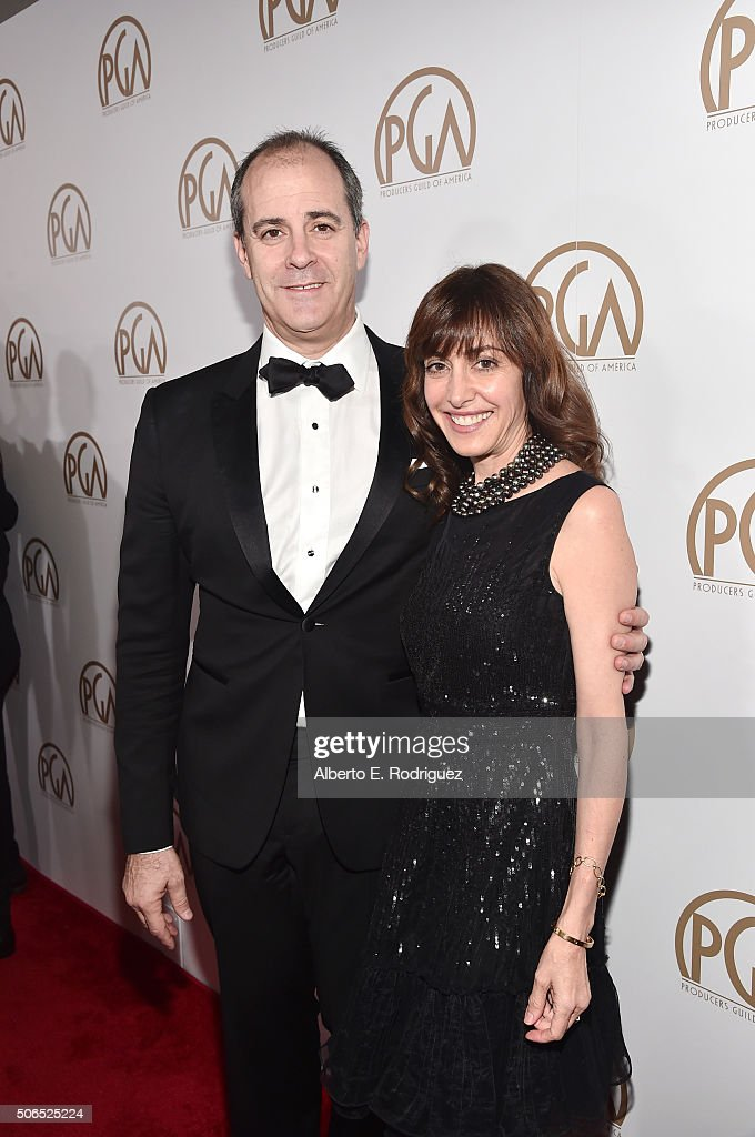 Producer David Nevins (L) and guest attend the 27th Annual Producers Guild Of America Awards at the Hyatt Regency Century Plaza on January 23, 2016 in Century City, California.