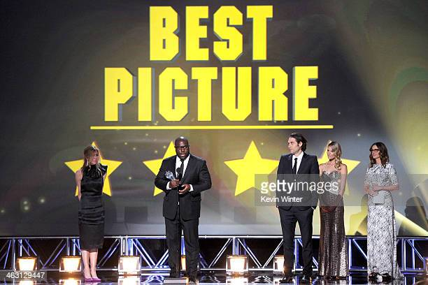 Producer Dede Gardner director Steve McQueen and producer Jeremy Kleiner accept the Best Picture award for '12 Years a Slave' from actress Julia...