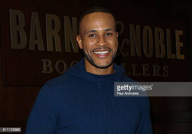 Producer Devon Franklin and Actress Meagan Good sign copies of their new book 'The Wait A Powerful Practice For Finding The Love Of Your Live And The...