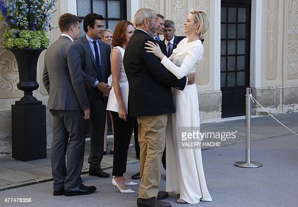 US producer Dick Wolf embraces and Princess Charlene of Monaco in Monaco Palace during the 55th MonteCarlo Television Festival on June 17 in Monaco...