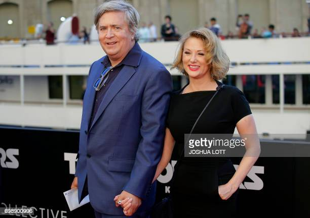 Producer Don Murphy and his wife Susan Montford arrive for the premiere of 'Transformers The Last Knight' on June 20 in Chicago Illinois / AFP PHOTO...