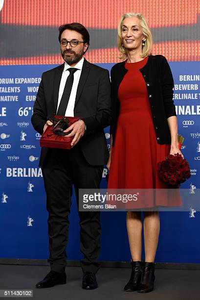 Producer Dora Bouchoucha and director Mohamed Ben Attia winner of the Best First Feature Award for his movie 'Inhebbek Hedi' attend the award winners...