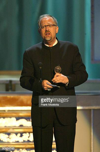 Producer Doug Wright winner of 'Best Play' for 'I Am My Own Wife' appears on stage during the '58th Annual Tony Awards' at Radio City Music Hall on...
