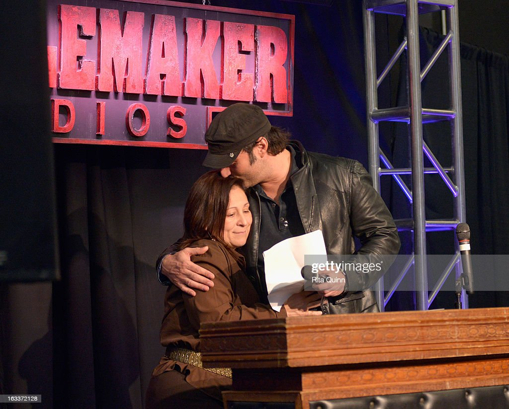 Producer Elizabeth Avellan and filmmaker Robert Rodriguez speak at the Private Filmmaker Luncheon during the 2013 SXSW Music, Film + Interactive Festival at Troublemaker Studios on March 8, 2013 in Austin, Texas.